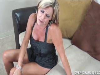 Busty mature lady jerking