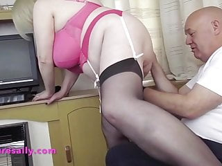 Mature big tits blonde wearing stockings and heels