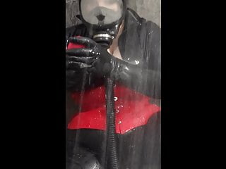 Latex rubber and gasmask in the shower with my new vibrator