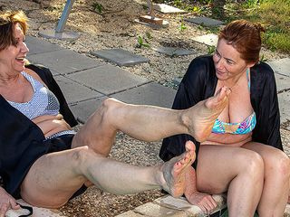 2 mature buddies get their girly-girl groove on at the pool
