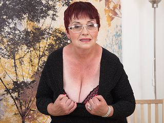 Ultra-Kinky granny plays with her boobs and wooly labia