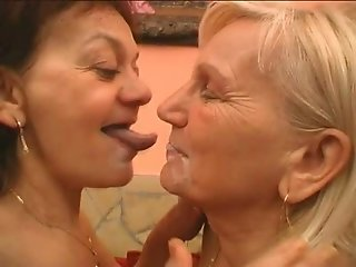 Two mature sluts lick each other's cunts on a sofa
