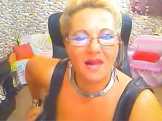Lusty big breasted MILF in sexy tight dress and high boots flashed her ass