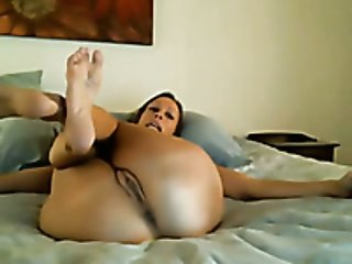 My flexible wife entertains herself by toying her hot pussy