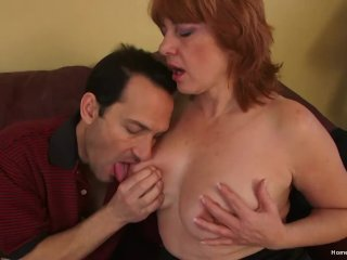 'Busty mature redhead screams as she gets pounded hard'