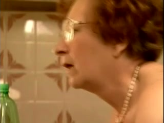 Aroused granny in glasses gets banged in the kitchen by a hot guy