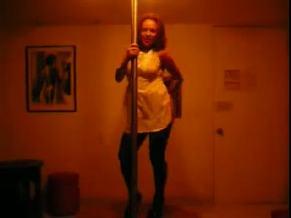 Black playful housewife on the pole trying to dance