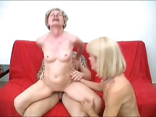 Two hot blonde moms share a stone-hard dick in FFM scene