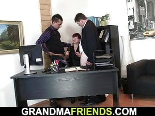 Two dudes share shaved office pussy, old lady