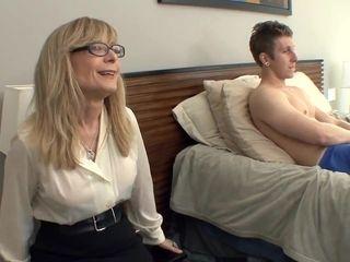 Massive splatter milf Nina Hartley tempts in stocking and a garter