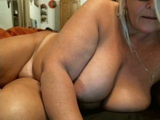 Giant breasted blonde mature whore is so into masturbating herself