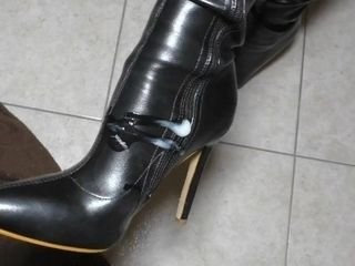 'Male sub got horny with mistress boots and red stockings. He fucked her boots and jizz on them.'