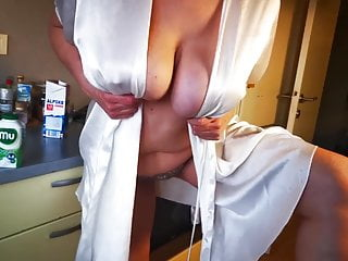 Mature show her big natural boobs in kitchen
