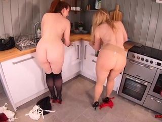 Red XXX and her naughty girlfriend fuck in the kitchen