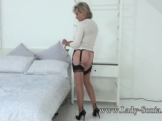 Female Sonia disrobes and plays with her vibro