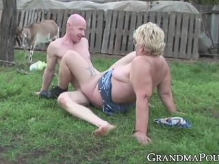Kinky granny sucking cock outdoor and gets sprayed with cum