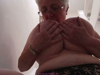 Check out brief haired mature whore in glasses who plays with her gigantic orbs