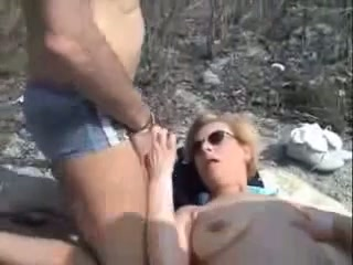 Sharing my lovely blonde wife with a stranger on the beach