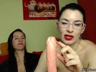 Mature lesbians playing with dildo on cam