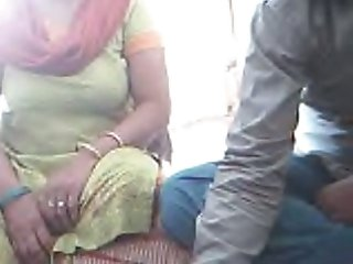 Horny Indian freak shows big tits of his wife on webcam