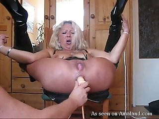 Flexible blond haired MILFie nympho in high boots gets holes fucked with toy