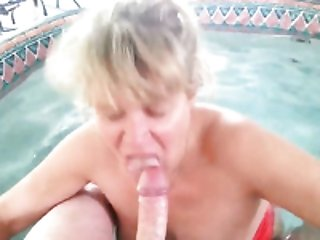 Mature slutty as fuck blonde lady sucked my buddy's dick in the pool