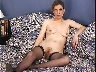 Mature French mom masturbating passionately in solo video