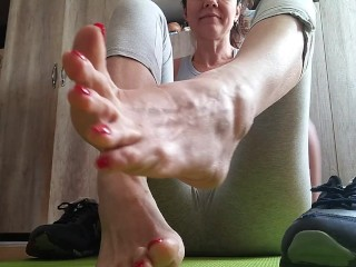 'Sweaty feet after workout. Stinky socks and sneakers.Sniffing - OlgaNovem'