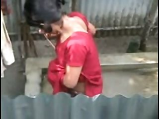 Mature ugly Indian brunette takes a shower outdoors and flashes tits
