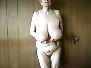 Ugly as shit and frightening webcam oldie played with her saggy tits